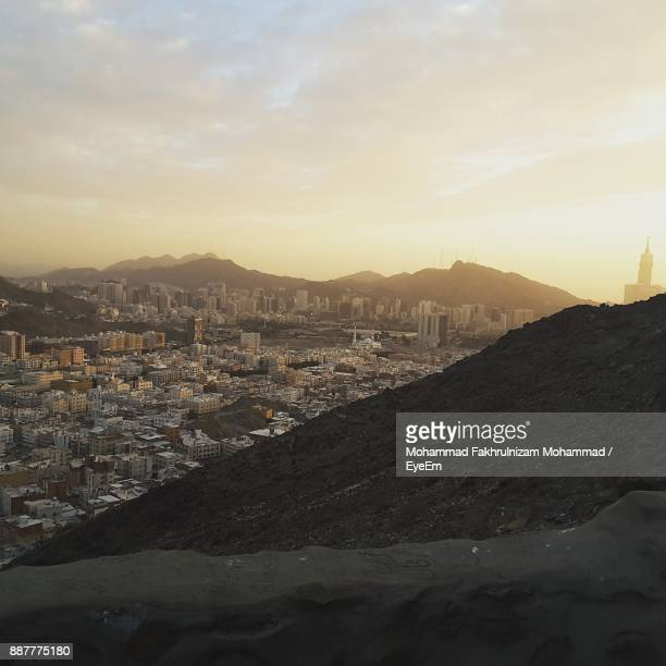 view of cityscape against sky - mecca stock photos and pictures