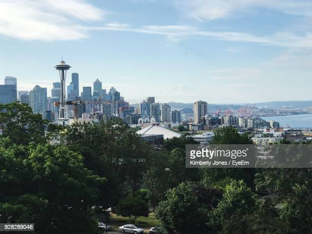 view of cityscape against sky - space needle stock-fotos und bilder