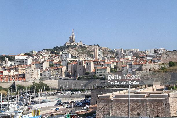 View Of Cityscape And Notre-Dame De La Garde Against Clear Blue Sky