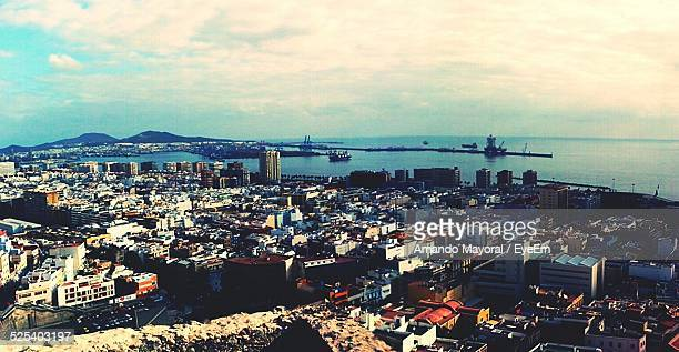 view of cityscape by sea against cloudy sky - las palmas de gran canaria stock pictures, royalty-free photos & images