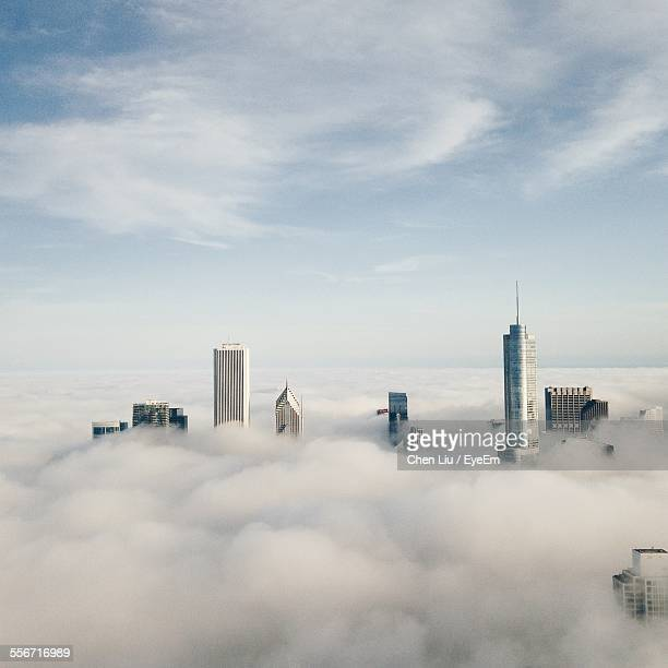 View Of Cityscape Covered With Clouds