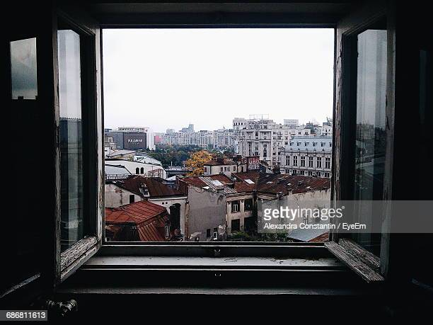 View Of Cityscape Through Window