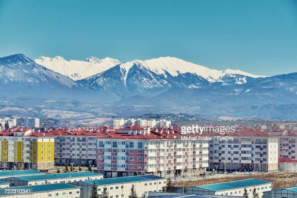 view of cityscape with mountain range in background - sochi stock pictures, royalty-free photos & images