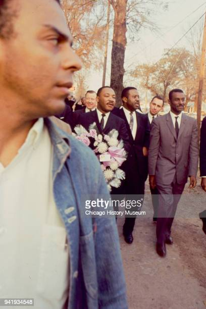 View of Civil Rights activist Andrew Young and among those behind him religious leaders Dr Martin Luther King Jr Reverend Ralph Abernathy and...