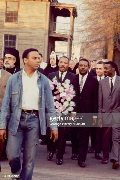 View of Civil Rights activist Andrew Young and among those behind him religious leaders Archbishop Iakovos Dr Martin Luther King Jr Reverend Ralph...