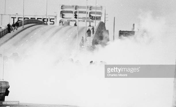 View of Civil Rights marchers in a cloud of tear gas at the base of the Edmund Pettus Bridge during the first Selma to Montgomery March, Selma,...