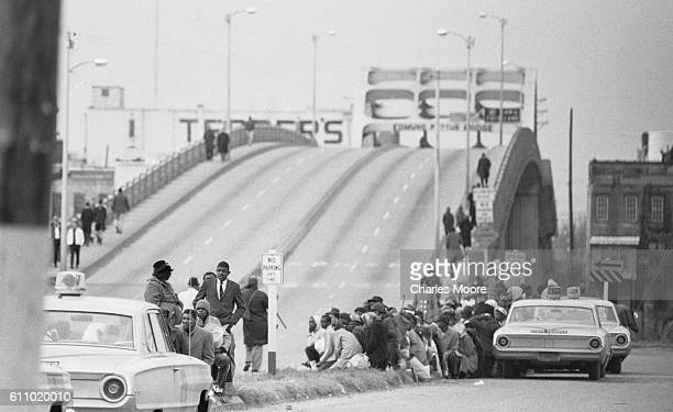 View of Civil Rights marchers on a median at the base of the Edmund Pettus Bridge during the first Selma to Montgomery March, Selma, Alabama, March...