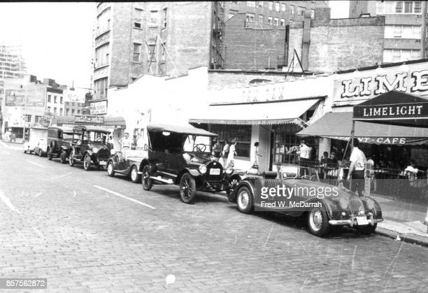 View of classic cars parked in front of the Limelight Coffee House during the seventh annual Village Voice Auto Rallye New York New York July 28 1963...