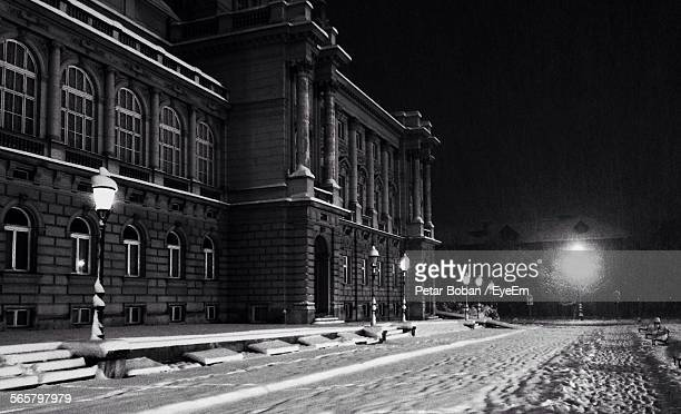 view of classical style building at night - boban stock pictures, royalty-free photos & images