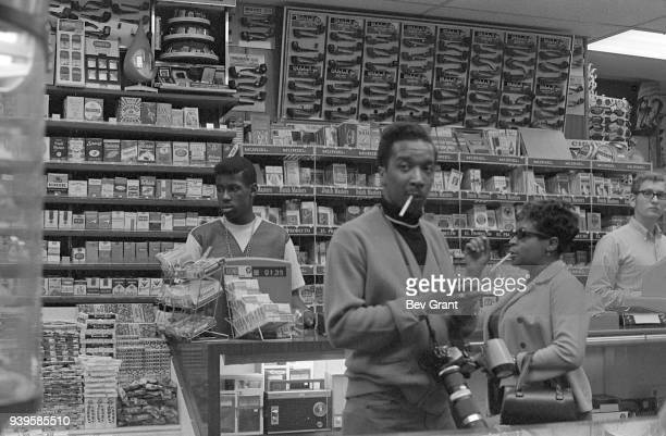 View of clerks and customers in an unidentified store that offers a wide range of cigarettes as well as other tobaccorelated products candy and...