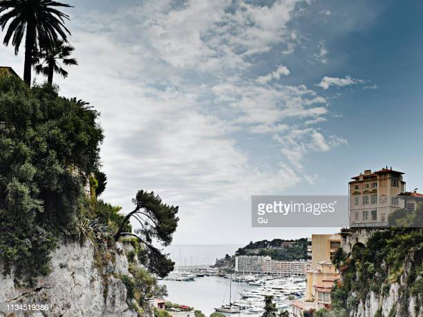 view of cliffs and harbor, monte carlo, monaco - monte carlo stock pictures, royalty-free photos & images