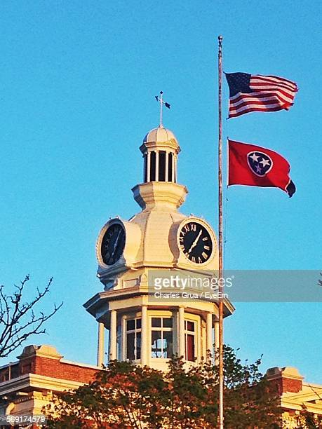 View Of Clock Tower And Flags