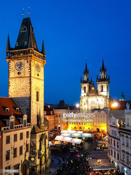 view of clock tower at night - astronomical clock prague stock pictures, royalty-free photos & images