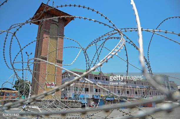 A view of clock tower in concertina razor wire of Indian government forces at the city center during a curfew following violence that has left over...