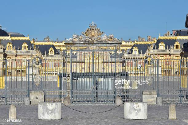 A view of closed gates in front of Chateau de Versailles on April 04 2020 in Versailles France The country is issuing fines for people caught...