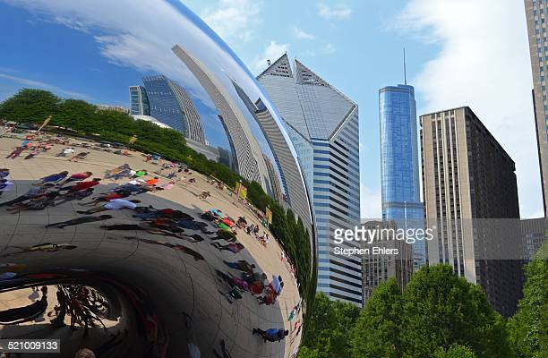 A view of Cloud Gate commonly called the Bean with the Chicago skyline