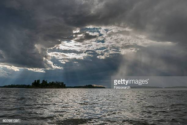 view of clouds over a lake - lake of the woods stock pictures, royalty-free photos & images
