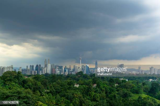 view of cloudy day over downtown kuala lumpur, capital city of malaysia. - shaifulzamri imagens e fotografias de stock