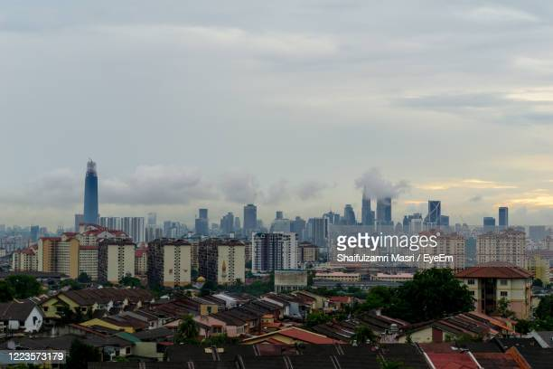 view of cloudy day over downtown kuala lumpur, capital city of malaysia. - shaifulzamri photos et images de collection