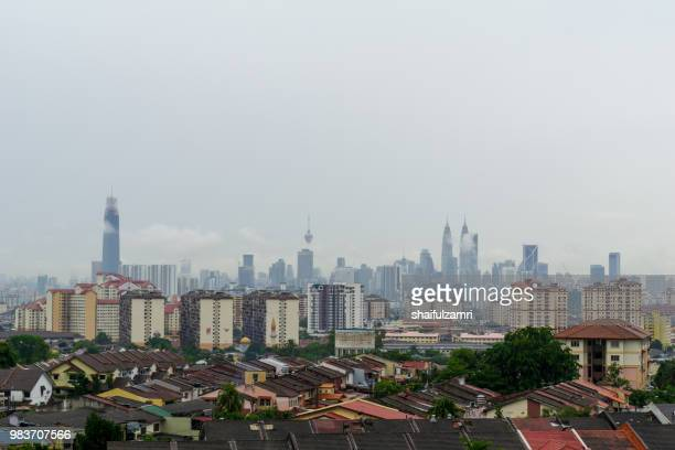 view of cloudy day over downtown kuala lumpur, capital city of malaysia. - shaifulzamri bildbanksfoton och bilder