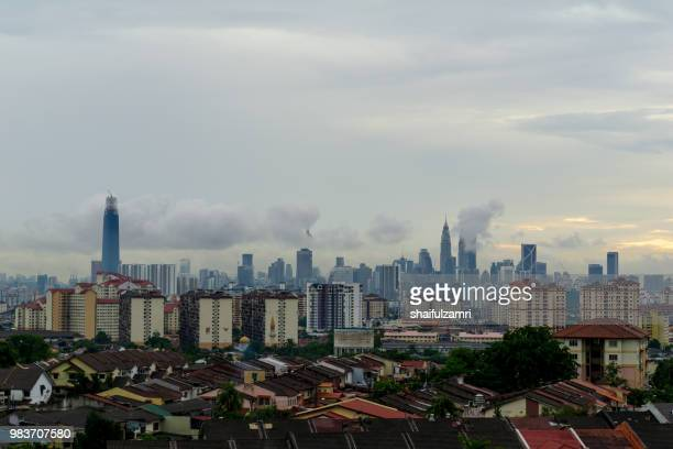 view of cloudy day over downtown kuala lumpur, capital city of malaysia. - shaifulzamri stock pictures, royalty-free photos & images