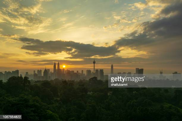 View of cloudy sunrise over downtown Kuala Lumpur, Malaysia