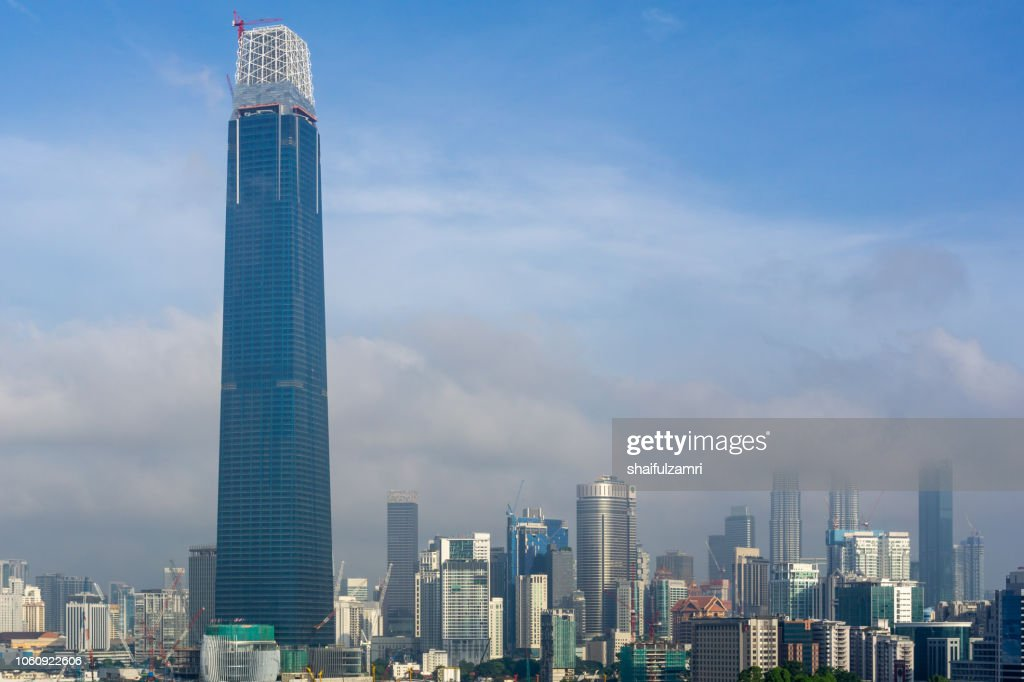 View of cloudy sunrise over Exchange 106 tower (formerly known as TRX Signature). The tower still under construction and will become highest tower in Malaysia. : Stock Photo