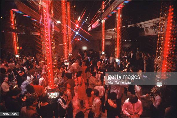 View of clubgoers amid the light towers on the dance floor at Studio 54 New York New York May 15 1978