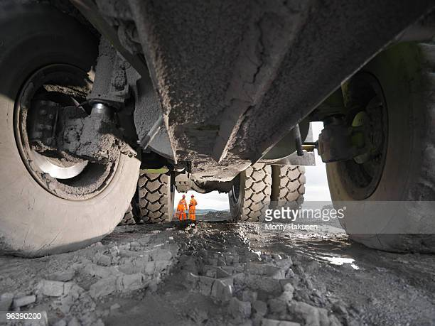 view of coal miners from under truck - oversized stock pictures, royalty-free photos & images