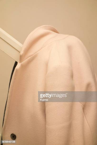 view of coat on bannisters - overcoat stock pictures, royalty-free photos & images