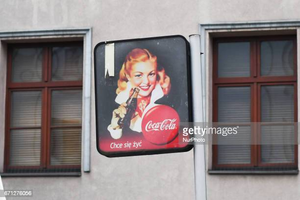 A view of CocaCola logo and add seen in Kazimierz area of Krakow On Thursday April 20 in Krakow Poland