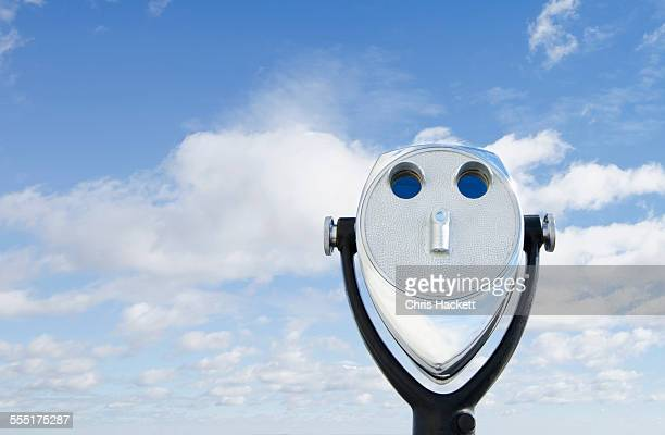 View of coin-operated binoculars against sky and clouds