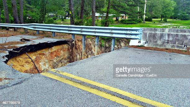view of collapsed road during landslide - house collapsing stock pictures, royalty-free photos & images