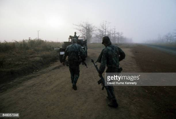 View of Colonial Portuguese soldiers on a dirt road at dawn near Ancuabe Cabo Delgado Province Mozambique July 27 1973 The country gained its...