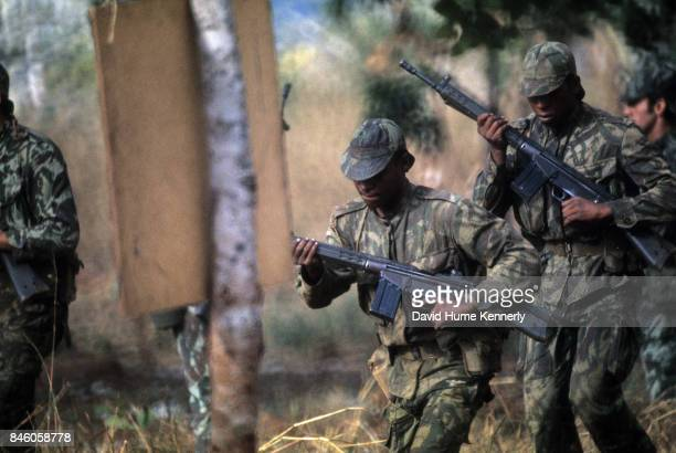 View of Colonial Portuguese soldiers run with their rifles during training Ancuabe Cabo Delgado Province Mozambique July 27 1973 The country gained...