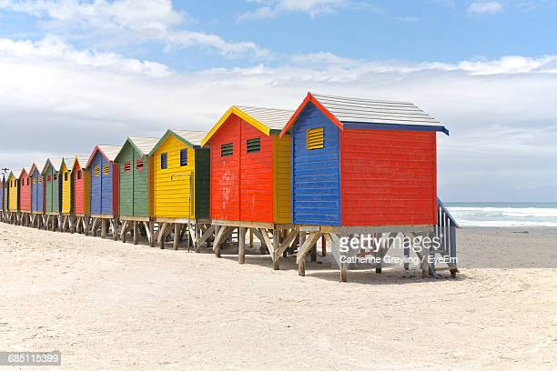 View Of Colorful Beach Huts On Sandy Beach