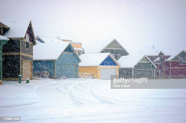 View of colorful houses in middle of snow storm