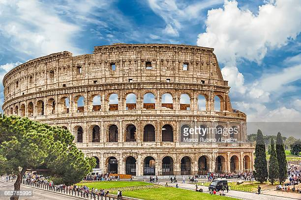 view of colosseum against the sky - coliseum rome stock photos and pictures