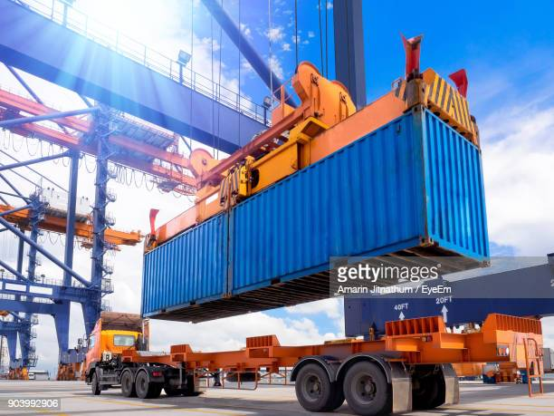 view of commercial dock against sky - docks stock pictures, royalty-free photos & images