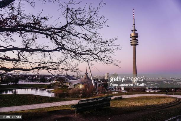 view of communications tower and buildings against sky - olympiastadion berlin stock pictures, royalty-free photos & images
