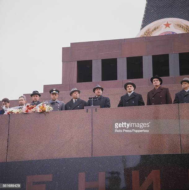 View of Communist Party members of the Soviet Politburo and cosmonauts lining up on the platform above Lenin's tomb in Red Square Moscow to welcome...