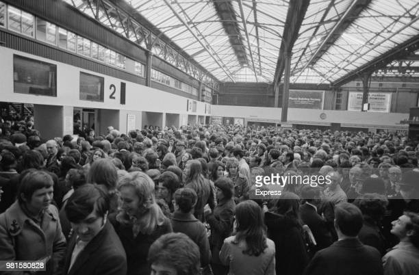 View of commuters and passengers crowded on to the concourse as they wait for delayed and cancelled British Rail Southern Region trains at Charing...