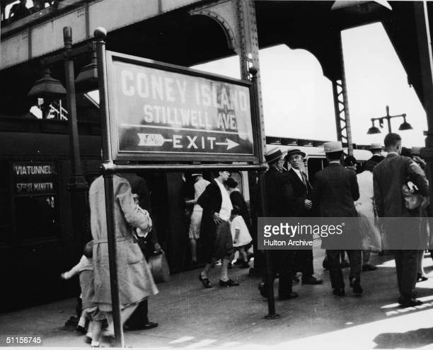 View of commuters as they walk along the platform after getting off a train at the Stilwell Avenue BMT stop at Coney Island New York 1920s