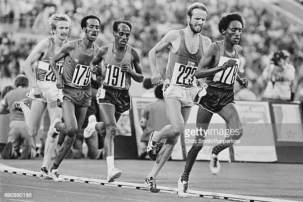 View of competition in the final of the Men's 10000 metres event with from left silver medallist Kaarlo Maaninka of Finland Tolossa Kotu of Ethiopia...
