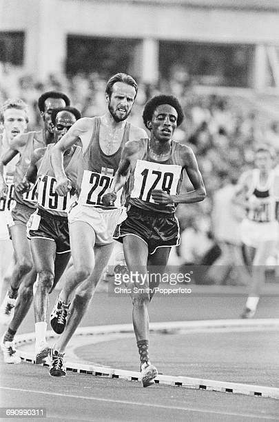 View of competition in the final of the Men's 10000 metres event with from left Tolossa Kotu of Ethiopia gold medallist Miruts Yifter of Ethiopia...