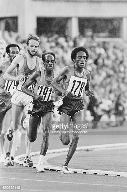 View of competition in the final of the Men's 10000 metres event with from left Tolossa Kotu of Ethiopia Lasse Viren of Finland gold medallist Miruts...