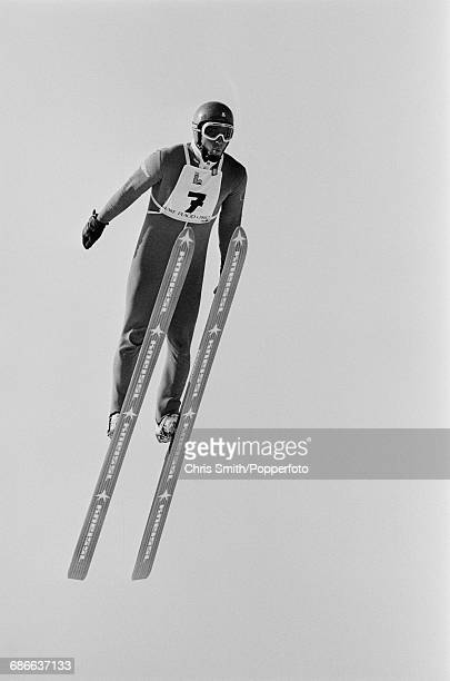 View of competitor pictured in action competing in the Men's ski jumping event at the 1980 Winter Olympics at Lake Placid Olympic Ski Jumping Complex...
