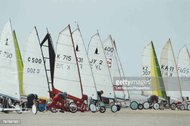 View of competitors lining up their sand yachts in position prior to competing in the land sailing World Championships on Blackpool Beach England in...