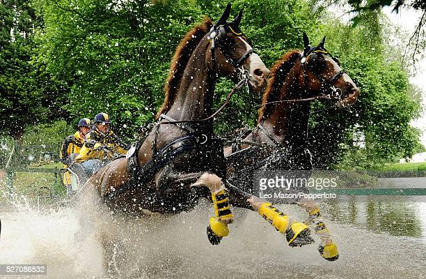 View of Competitors on the cross country marathon phase at the lake in the Land Rover International Driving GP during the 2009 Royal Windsor Horse...