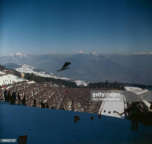 View of competitors taking part in the Ski jumping competition at the 1968 Winter Olympics held at SaintNizierduMoucherotte near Grenoble in France...